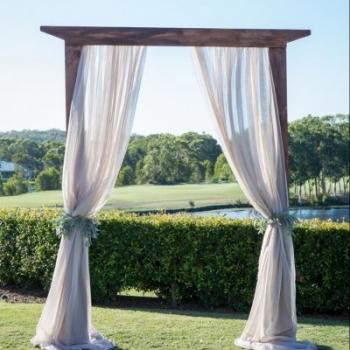 wooden rustic wedding arbor linen drapes