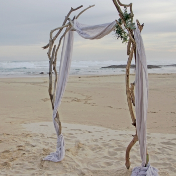 rustic driftwood arbor | arch grey linen drape