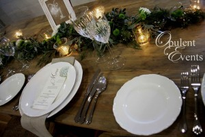 timber trestle table foliage garland centrepiece