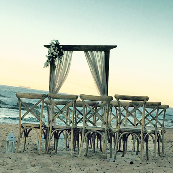 rustic wooden 2 post structure with natural linen drape