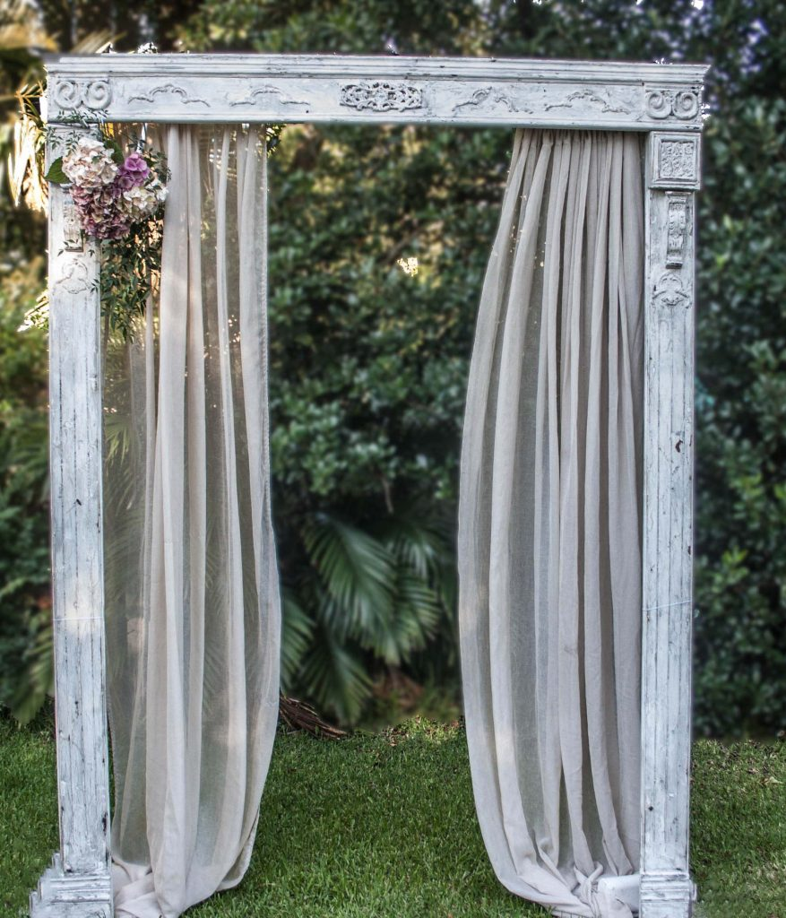 Antique white ornate wedding arch /arbor