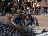 Deep rich blue linens and crystal glassware