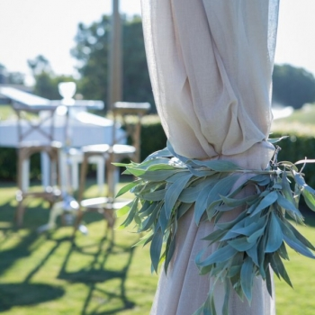 linen draped rustic wooden wedding ceremony arbor
