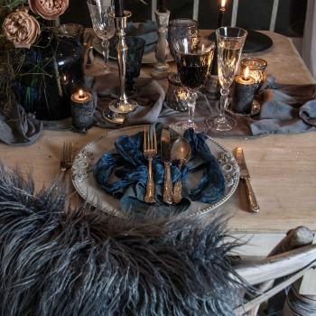 Deep blue linens and crystal glassware