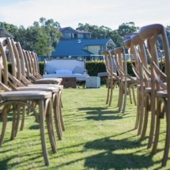 cross back timber chairs wedding ceremony