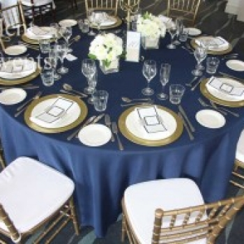 navy blue table cloth gold chargers gold tiffany chairs